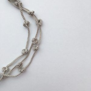 Beige multi strand necklace